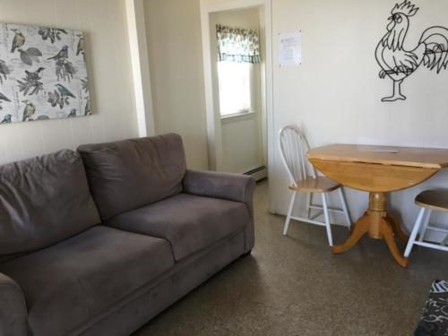 Kitchen 1, one bedroom unit; 2 double beds & a pull-out couch